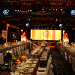 For an Annual Reception Dinner & Awards Ceremony, our team was presented with a new venue that was long and narrow with a low ceiling in which to create a branded, guest-friendly and television production quality decor environment.
