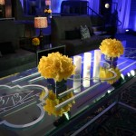 "For a family who appreciates the ""Art of Celebration"" their son's Bar Mitzvah included all his passions from Rap to Bling! Dubbed the ""13/13 Club,"" we based the event on Rapper Jay-Z's 40/40 Club in Las Vegas. From ""Bling Boulevard"" to fabulous VIP décor, hydrogen walls and entertainment including MTV's DJ Skribble and Rapper T.I. the event was pure 21st Century! It was a kid friendly environment that found common ground with their parent's passion to party."